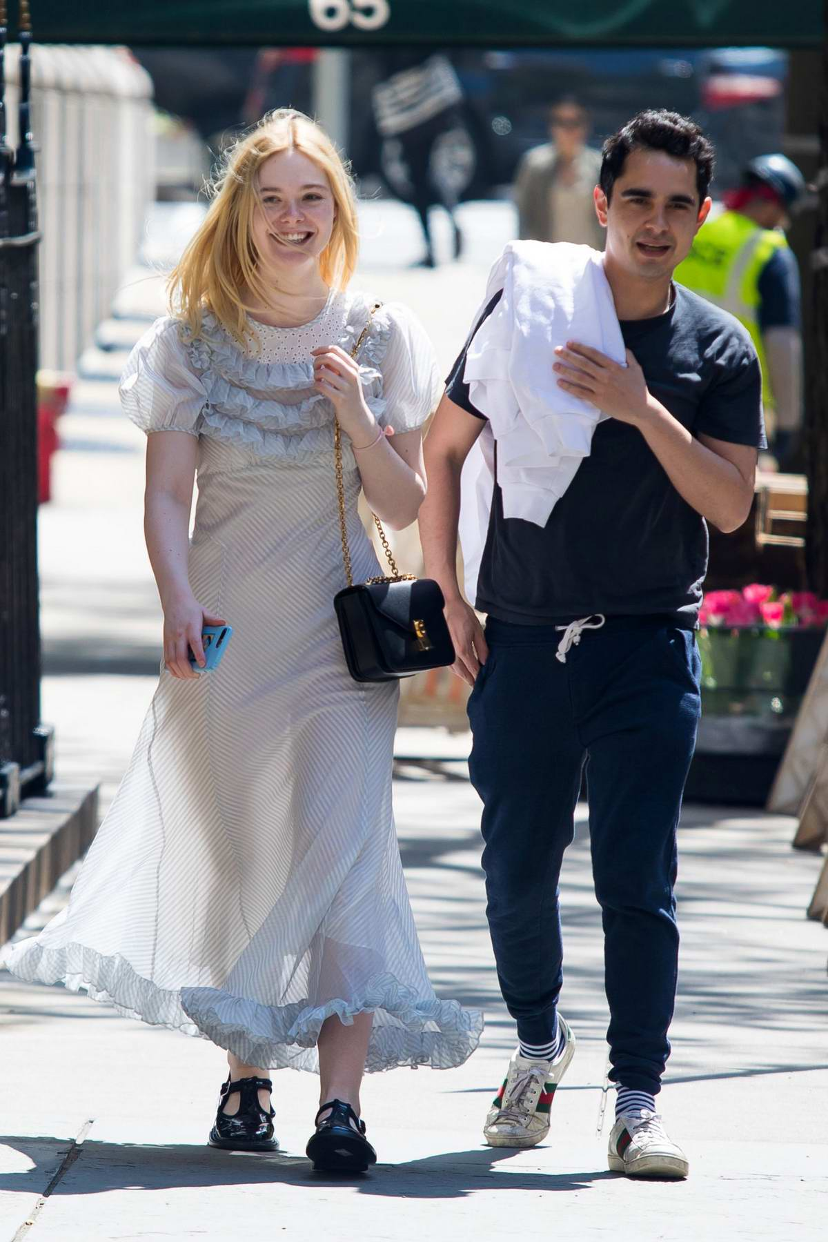 Elle Fanning is all smiles as she steps out with Max Minghella in New York City