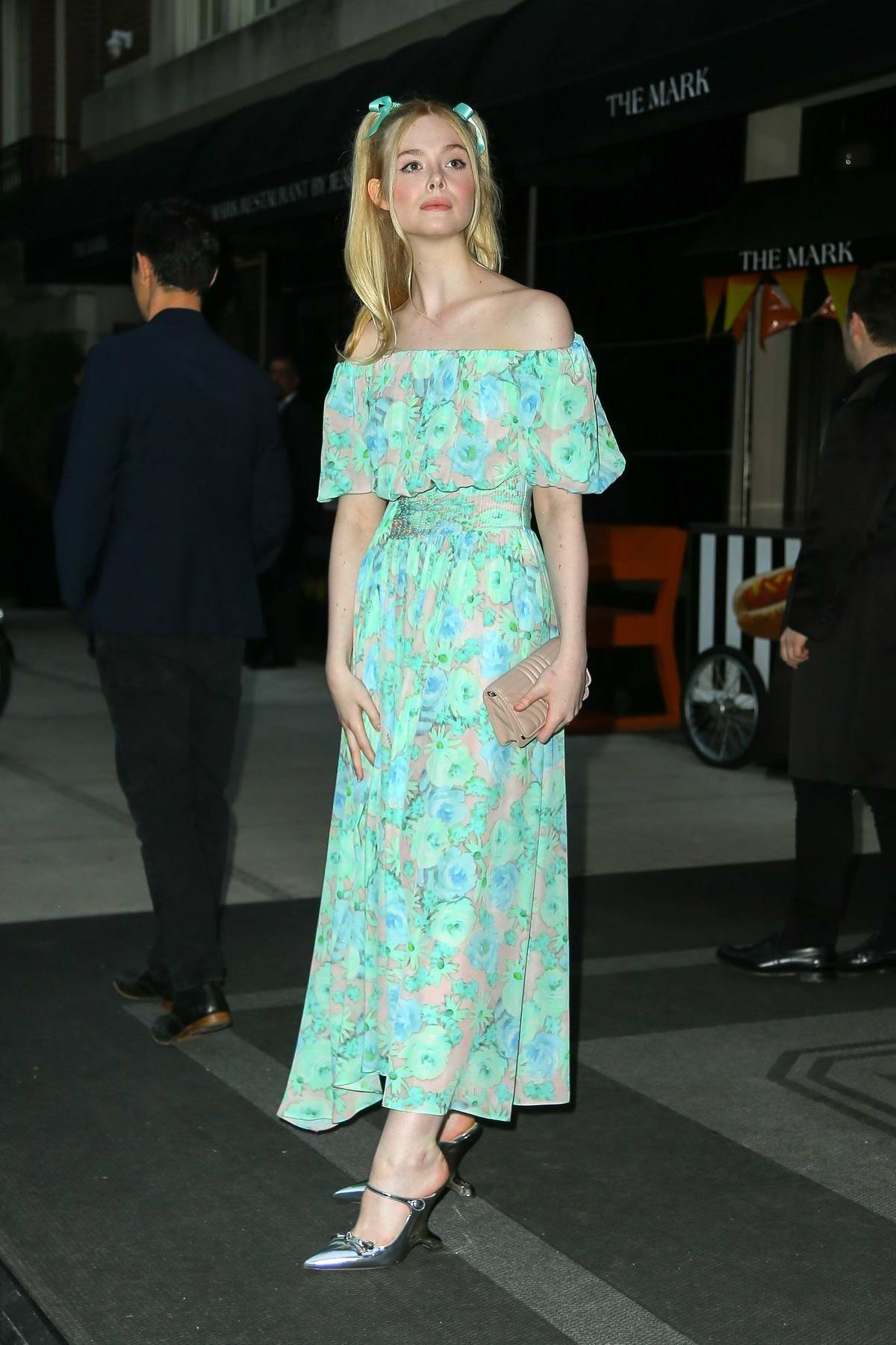 Elle Fanning looks adorable in a floral dress as she heads to the Prada event with Max Minghella in New York City
