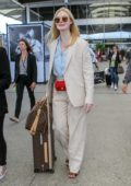 Elle Fanning looks fashionable in a cream pantsuit as she lands at the Nice Airport ahead of the 72nd Cannes Film Festival, France