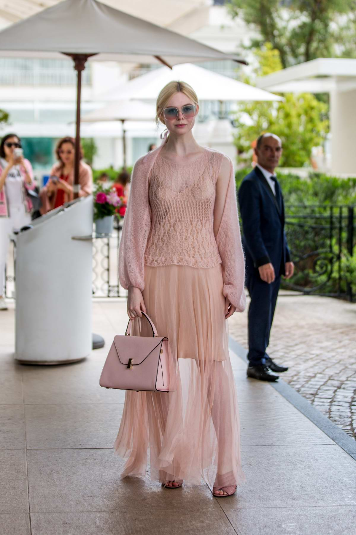 Elle Fanning looks pretty in a blush colored dress as she leaves the Hotel Martinez during the 72nd Cannes Film Festival in Cannes, France
