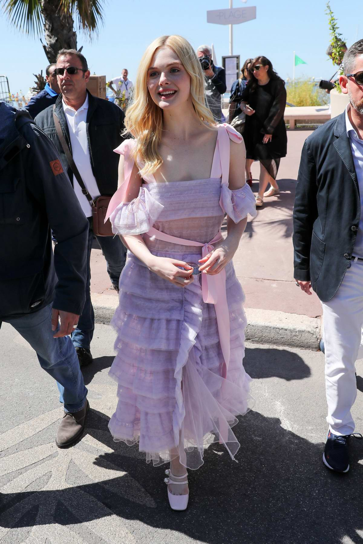 Elle Fanning looks pretty in a lavender dress outside the Martinez hotel during the 72nd Cannes Film Festival in Cannes, France