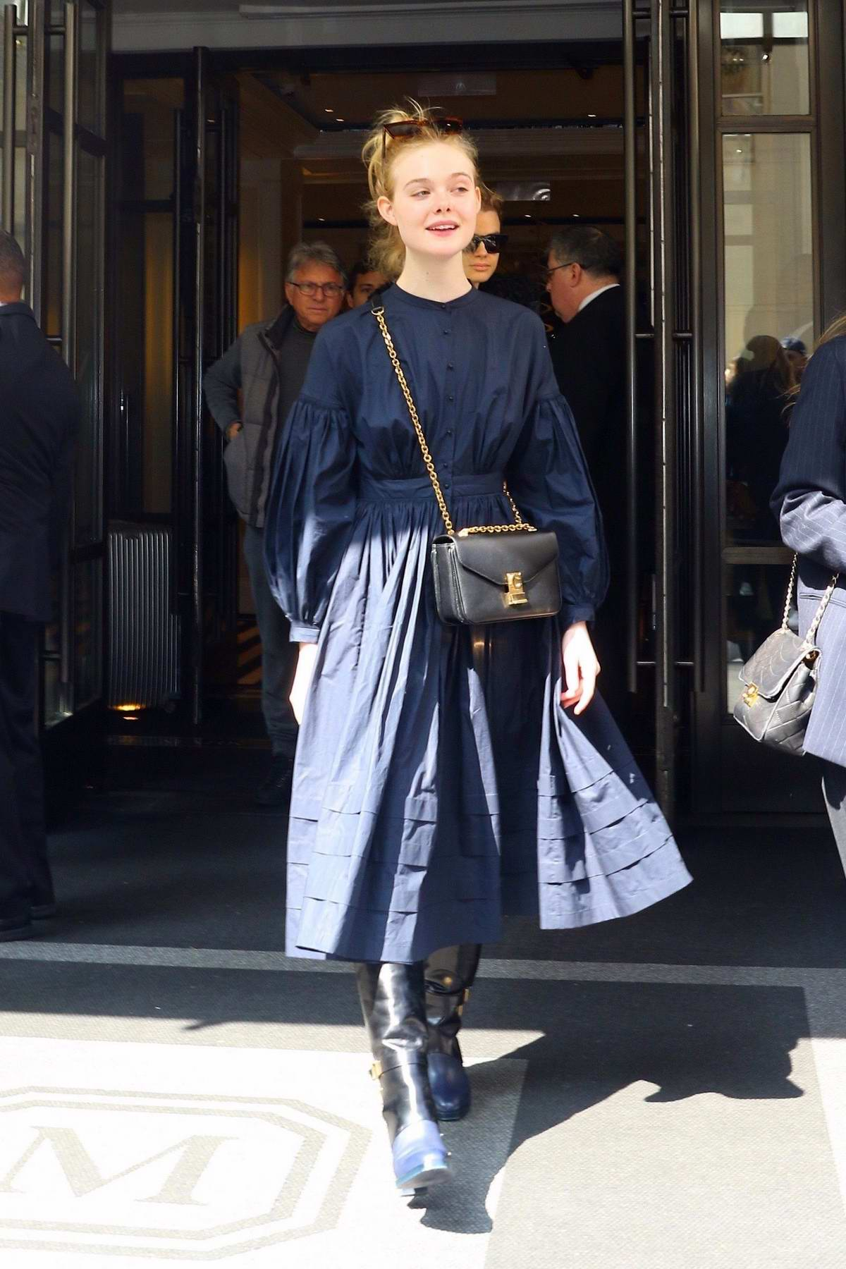 Elle Fanning looks pretty in a long sleeved navy blue dress while heading out in New York City