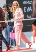 Elle Fanning looks pretty in a pink suit at the Martinez hotel during the 72nd annual Cannes Film Festival in Cannes, France
