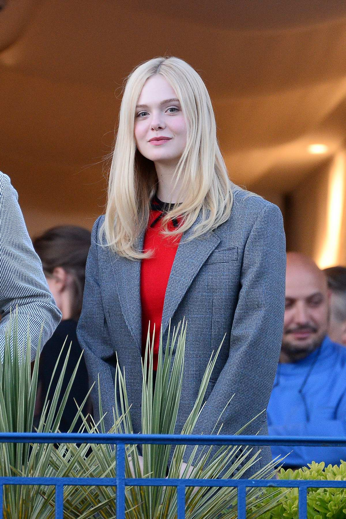 Elle Fanning seen on the balcony of the Martinez Hotel on the eve of the opening of the 72nd Cannes Film Festival in Cannes, France