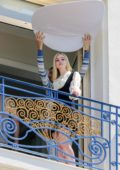 Elle Fanning spotted during a photoshoot on the balcony of Martinez hotel during the 72nd Cannes Film Festival in Cannes, France