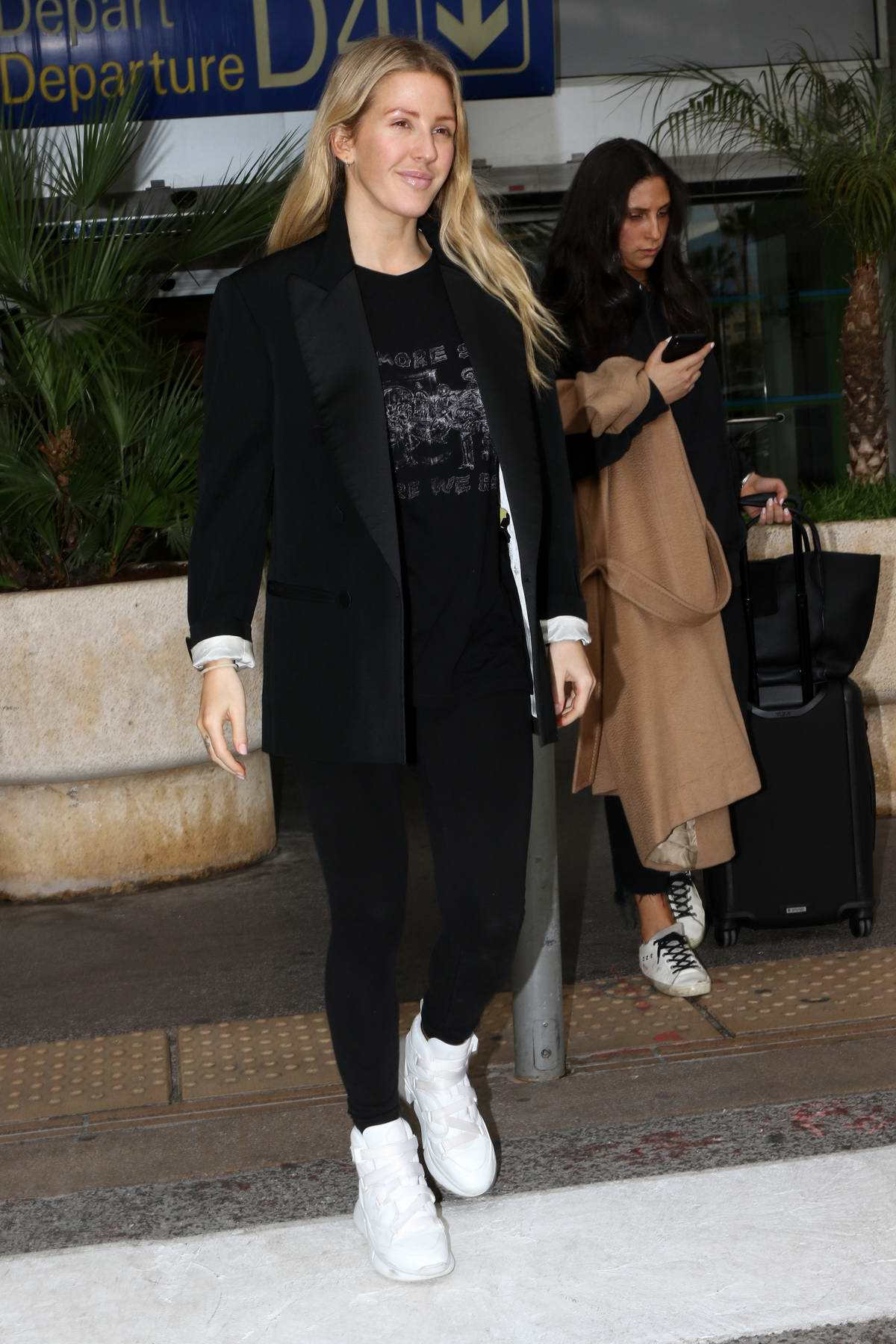 Ellie Goulding is all smiles as she arrives at Nice Airport for the 72nd annual Cannes Film Festival, France