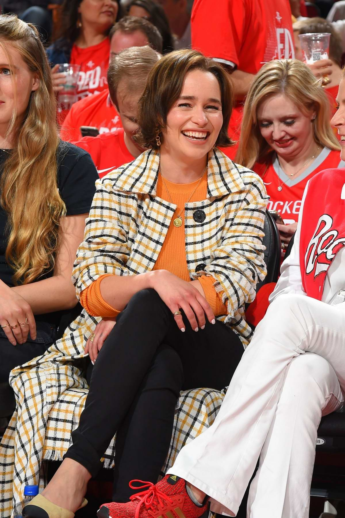 Emilia Clarke seen courtside at the Golden State Warriors v Houston Rockets game at Toyota Center in Houston, Texas