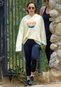 Emilia Clarke sports a yellow hoodie and black Nike leggings and trainers while out for a hike in Los Angeles