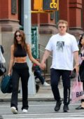 Emily Ratajkowski and her husband Sebastian Bear-McClard are all smiles holding hands while out in New York City
