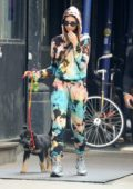 Emily Ratajkowski sports a colorful tie-dye sweatsuit as she takes her pup out for a stroll in New York City