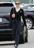 Emma Roberts wears a black cardigan and jeans while out for an iced coffee in Los Angeles