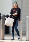 Emma Watson keeps it casual in sweatshirt and jeans as she arriving at JFK Airport in New York City