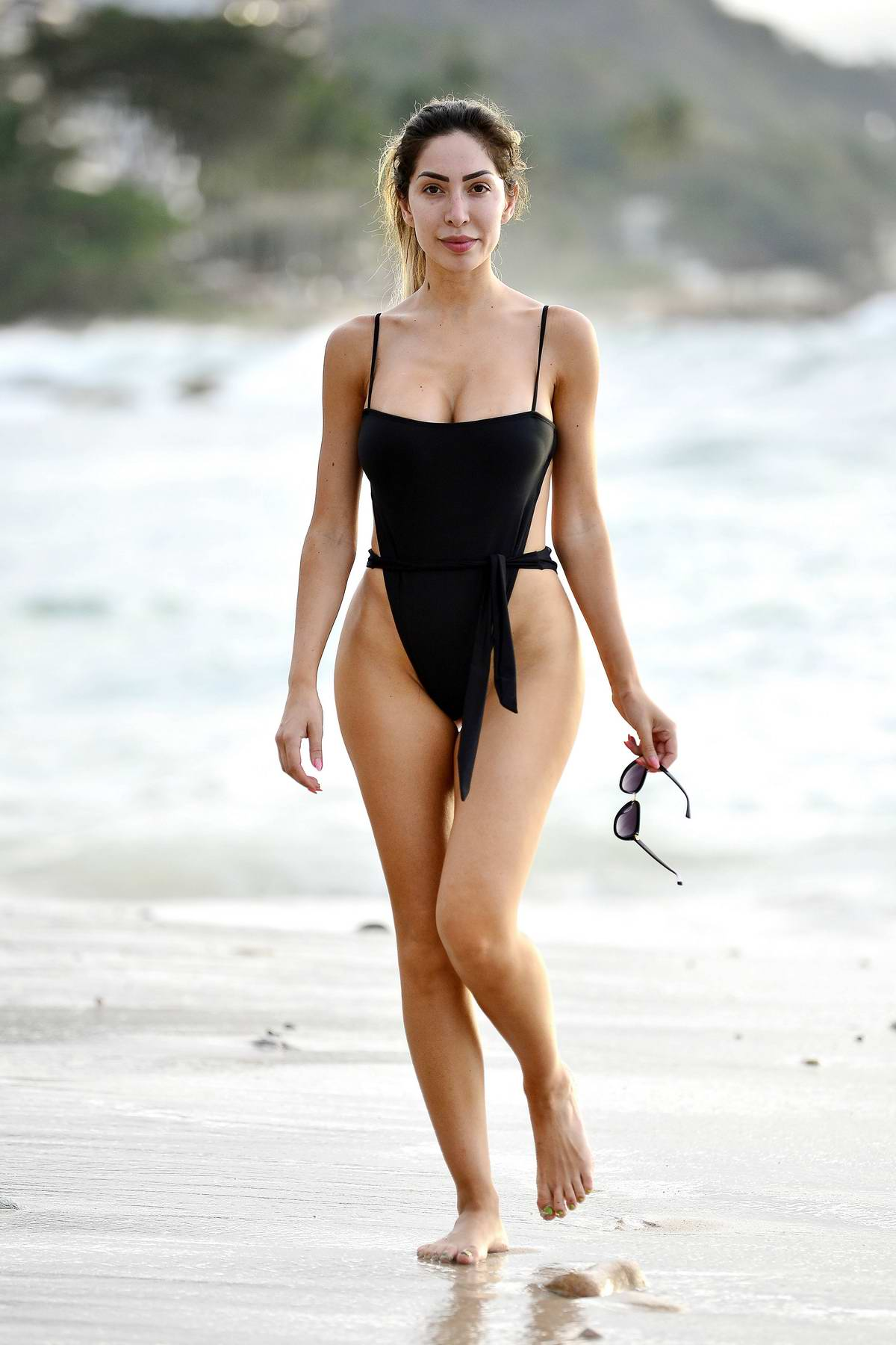 Farrah Abraham frolics at the beach in a black swimsuit during her vacation in Puerto Vallarta, Mexico