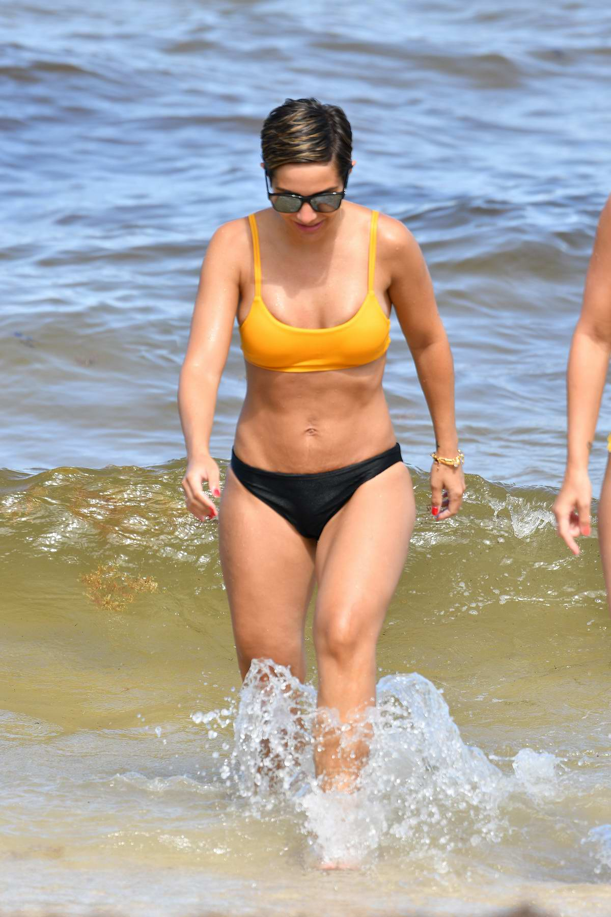 Frankie Bridge shows off her bikini body as she spends an afternoon relaxing on the beach in Miami, Florida