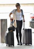 Freida Pinto wore a white tee and black leggings while she pushed her luggage through the LAX terminal in Los Angeles