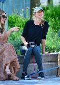 Gisele Bundchen seen chatting with friends while out for a walk with her dogs in New York City