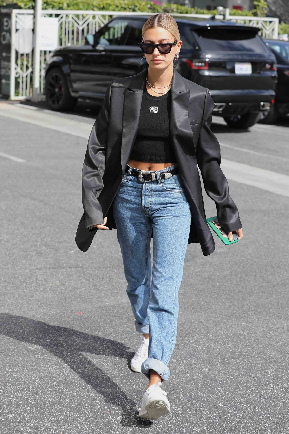 Hailey Baldwin is looking stylish in a black blazer and crop top as she runs some errands in Los Angeles