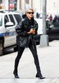 Hailey Baldwin looks dapper in all black ensemble as she arrives at an office building in Manhattan, New York City