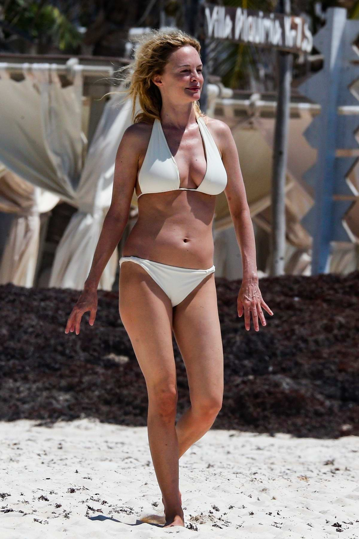 Heather Graham spotted in a white bikini at the beach as she enjoys her vacation in Tulum, Mexico