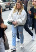Hilary Duff wears a white jacket and ripped jeans while out for stroll in New York City