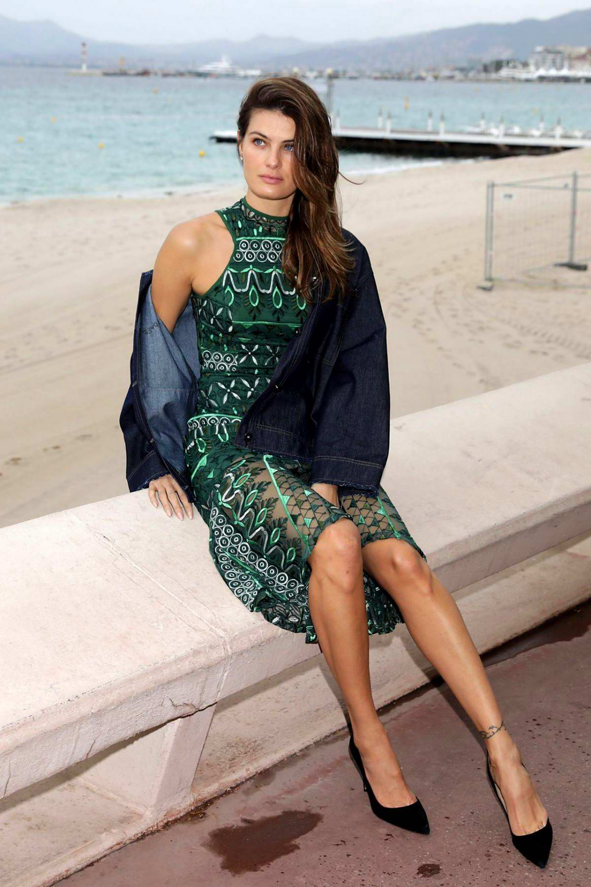 Isabeli Fontana poses in a green dress for some photos while out during the 72nd Cannes Film Festival in Cannes, France