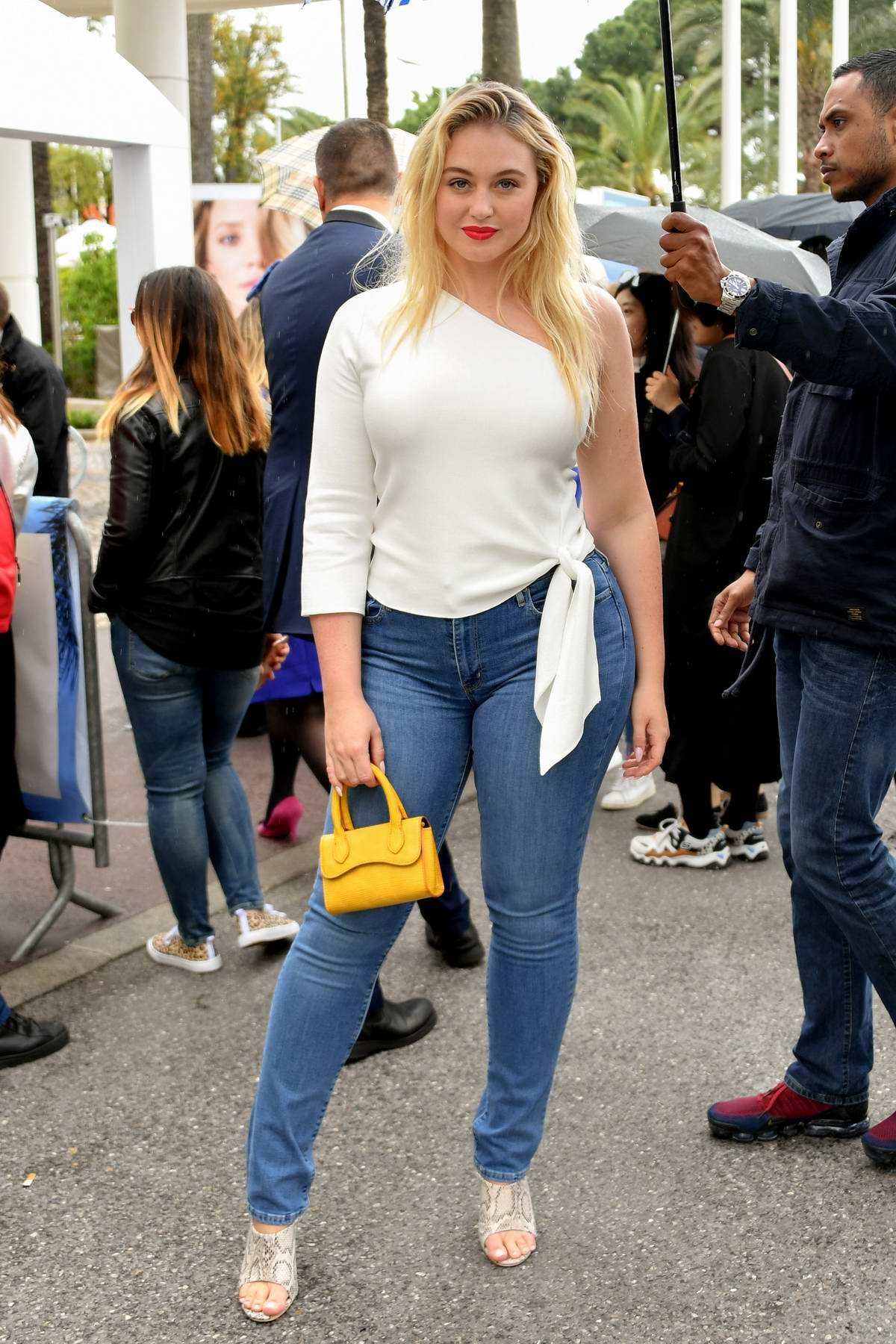 Iskra Lawrence looks amazing in a white top and tight blue jeans while out on the Croisette during the 72nd Cannes Film Festival in Cannes, France