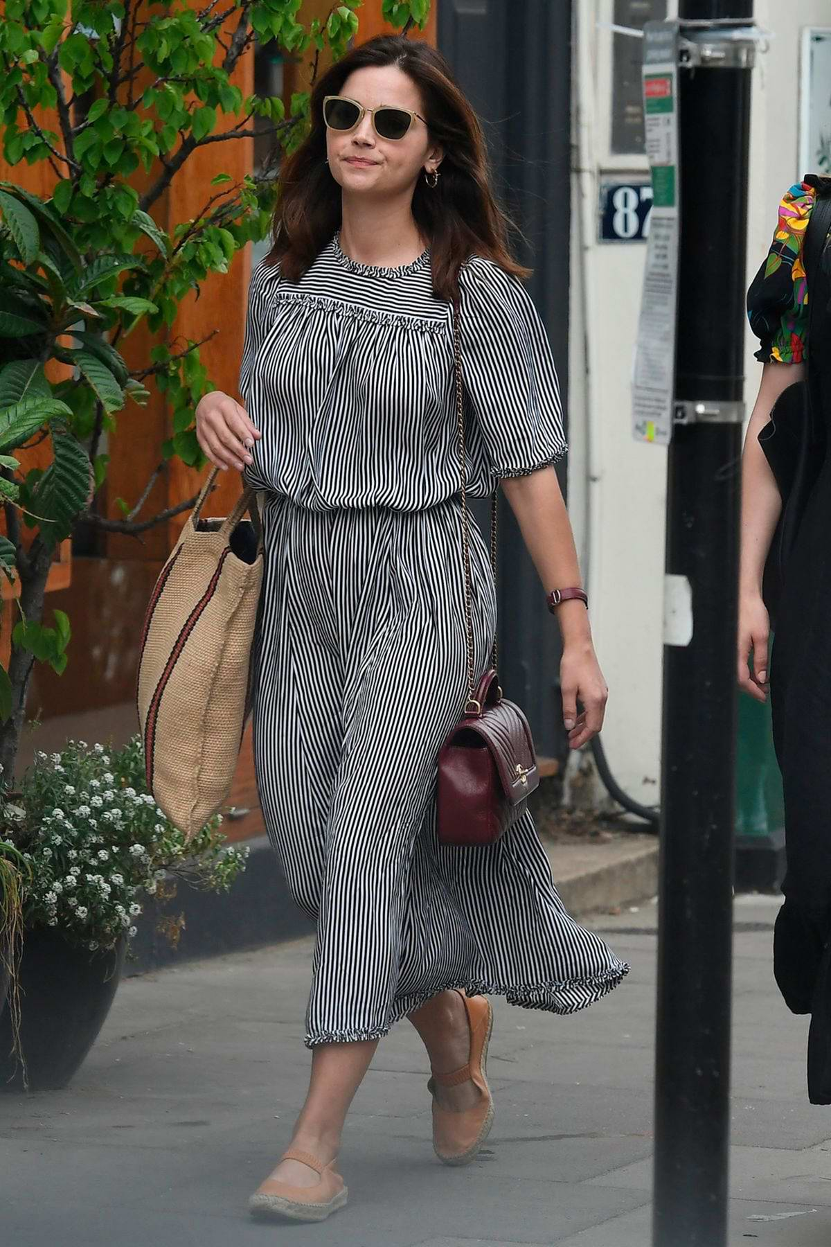 Jenna Coleman stepped out for a stroll in a monochrome dress in London, UK