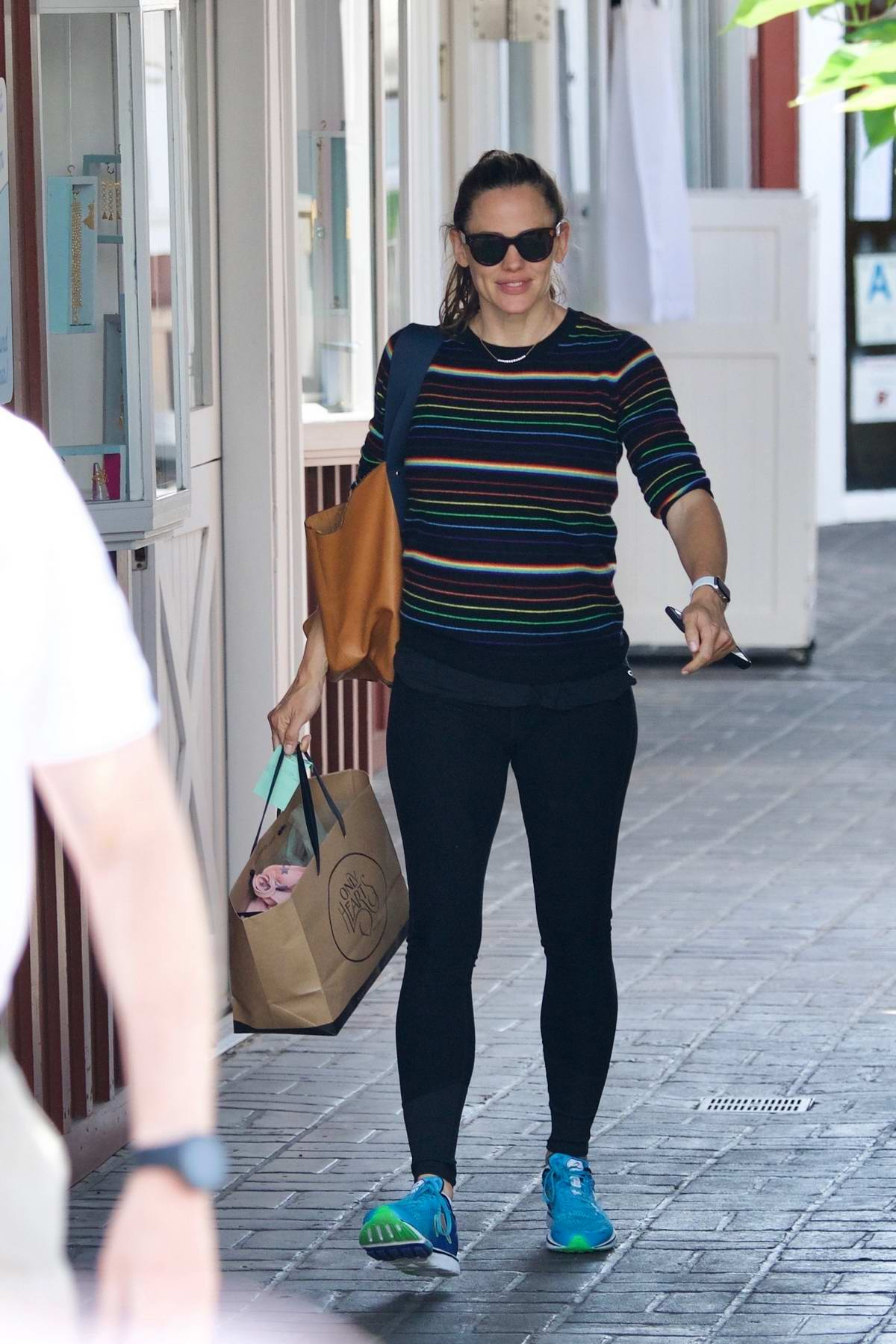 Jennifer Garner dons a colorful striped sweater and black leggings while out for some shopping at Brentwood Country Mart in Los Angeles