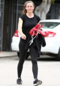 Jennifer Garner smiles for the camera as she leaves a boxing class wearing a black top and leggings in Santa Monica, California