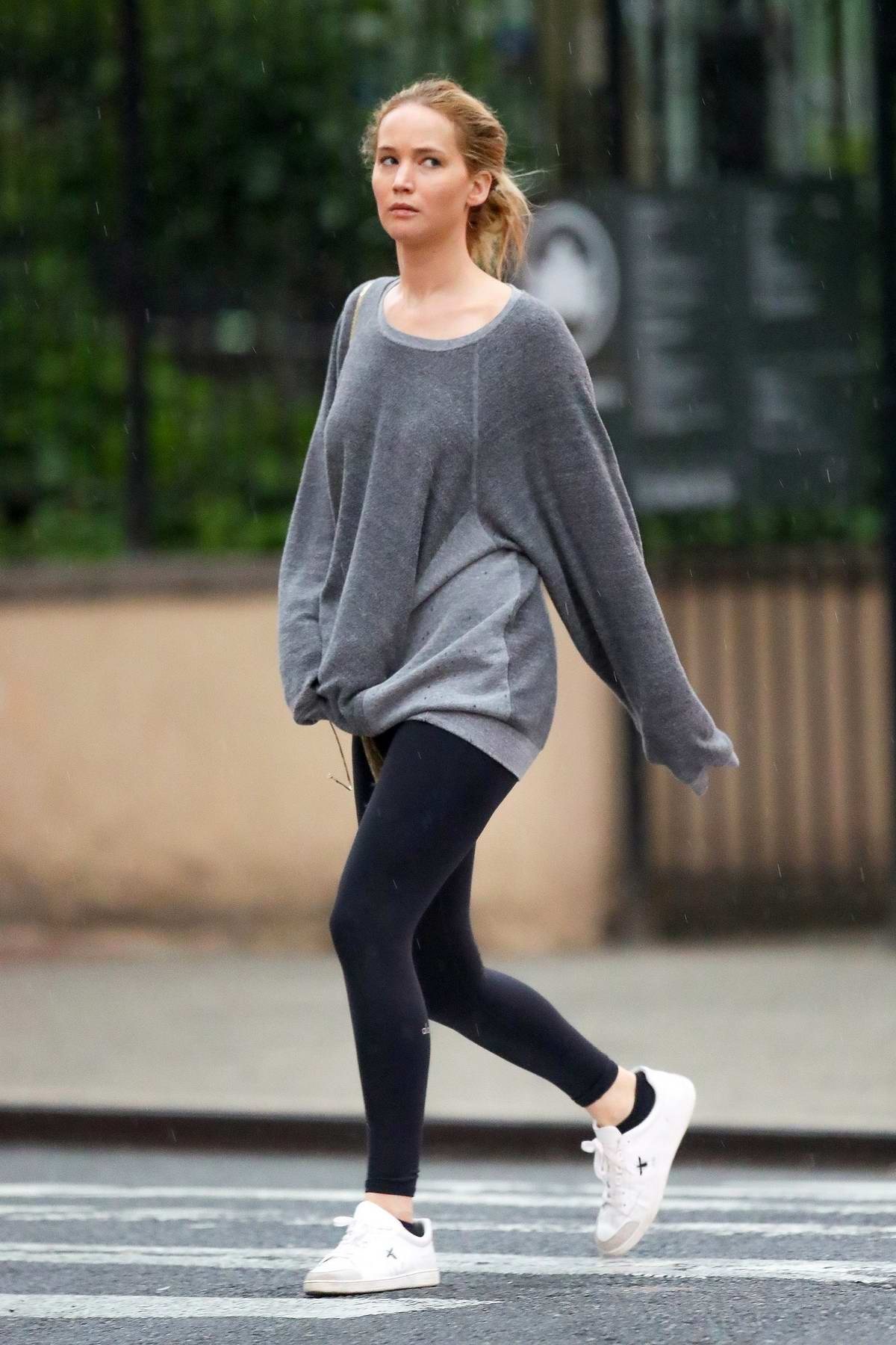 Jennifer Lawrence Wears A Grey Sweatshirt And Black