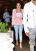 Jennifer Lopez is pretty in pink as she grabs dinner with friends at Avra in Beverly Hills, Los Angeles