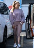 Jennifer Lopez wears a purple sweatshirt and leggings as she hits the gym in Miami, Florida