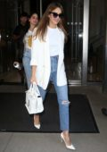 Jessica Alba keeps it chic in a white blazer with matching handbag and heels as she heads out in New York City