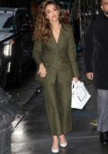 Jessica Alba looks stylish in a dark green suit as she steps out in New York City