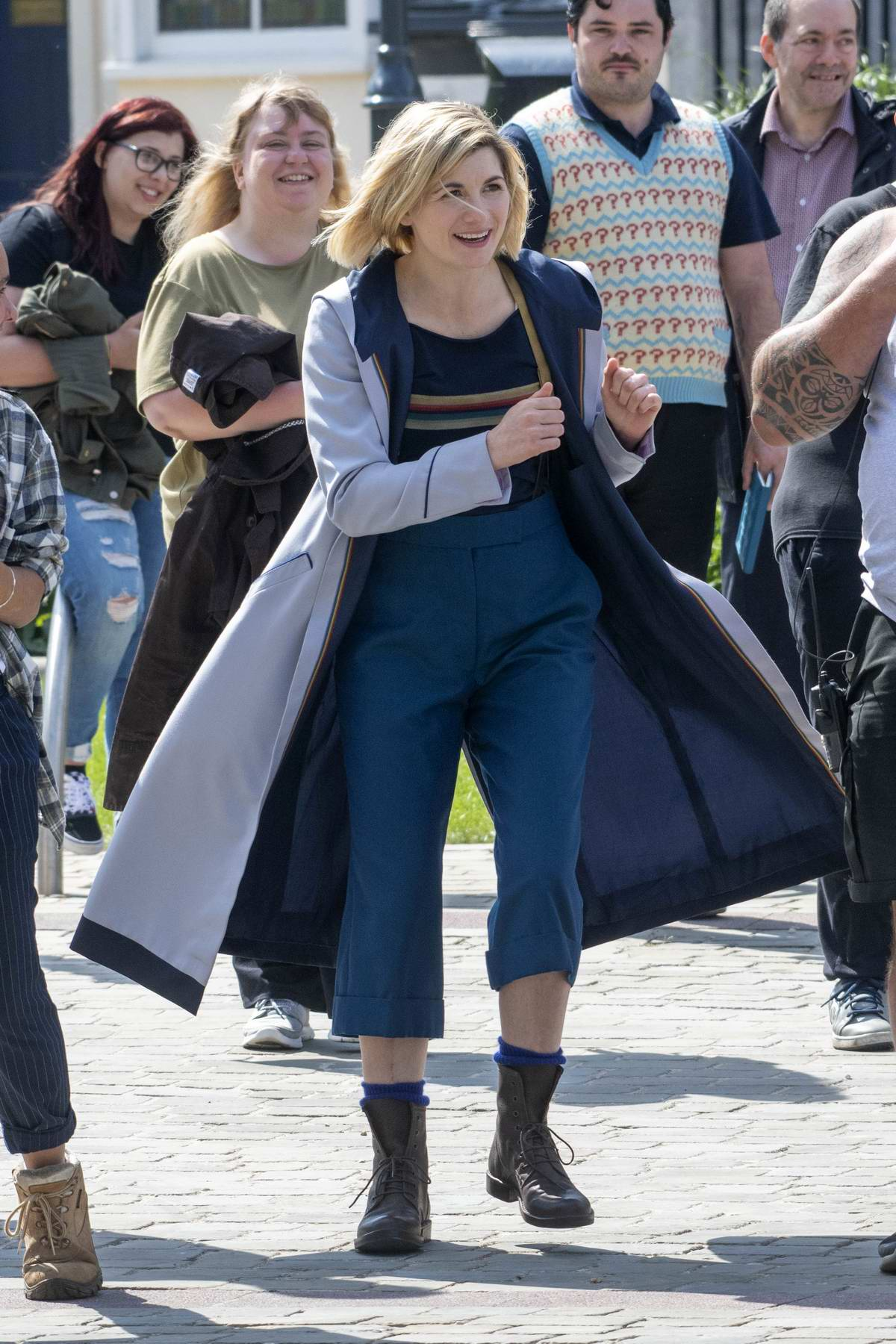 Jodie Whittaker greets her fans while filming for BBC's 'Doctor Who' at Gloucester Cathedral in Gloucester, UK
