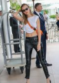 Josephine Skriver keeps it stylish in black leather pants as she heads out during the 72nd Cannes Film Festival in Cannes, France