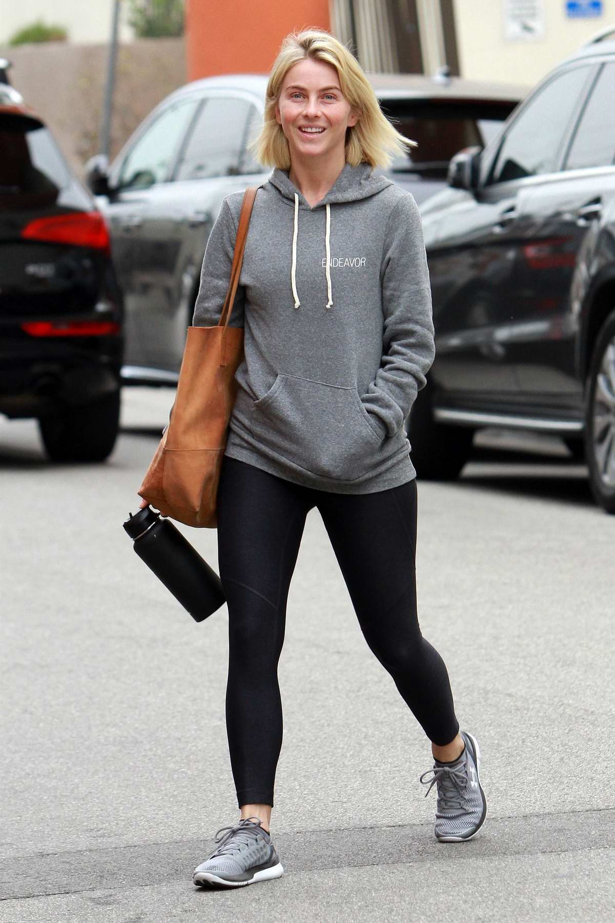 Julianne Hough sports a casual makeup free look with a smile as she hits the gym in Los Angeles
