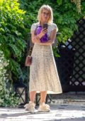 Julianne Hough spotted in an off-white floral print summer dress as she leaves a business meeting in Los Angeles