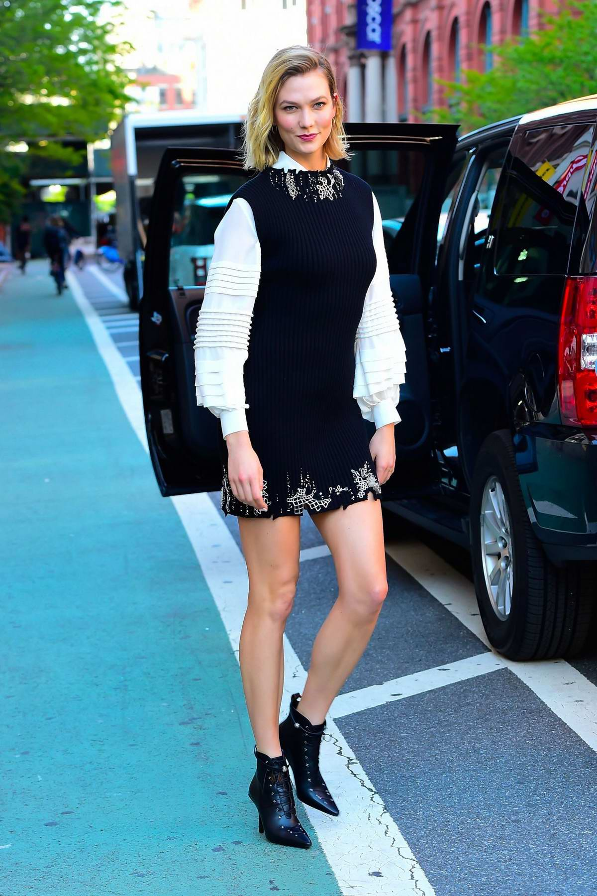 Karlie Kloss keeps it chic with black and white as she steps out in SoHo, New York City