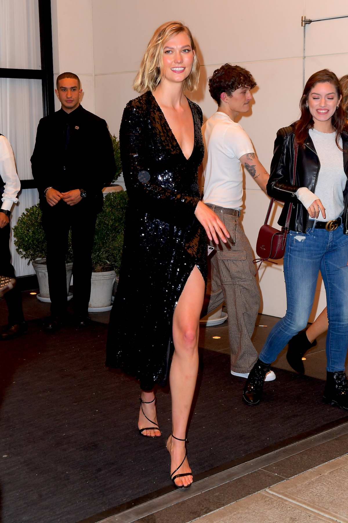 Karlie Kloss shimmers in a sequined black dress as she attends a Pre Met Gala Party at the Edition Hotel in Times Square, New York City