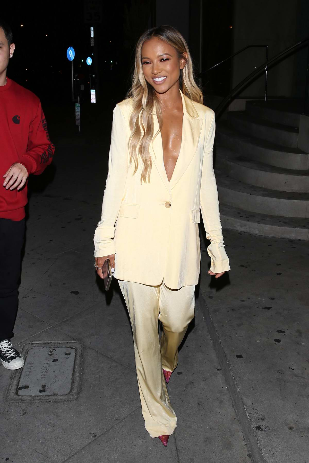 Karrueche Tran dressed in a gold suit celebrates her 31st birthday with friends and family at 'Catch LA' in West Hollywood, Los Angeles