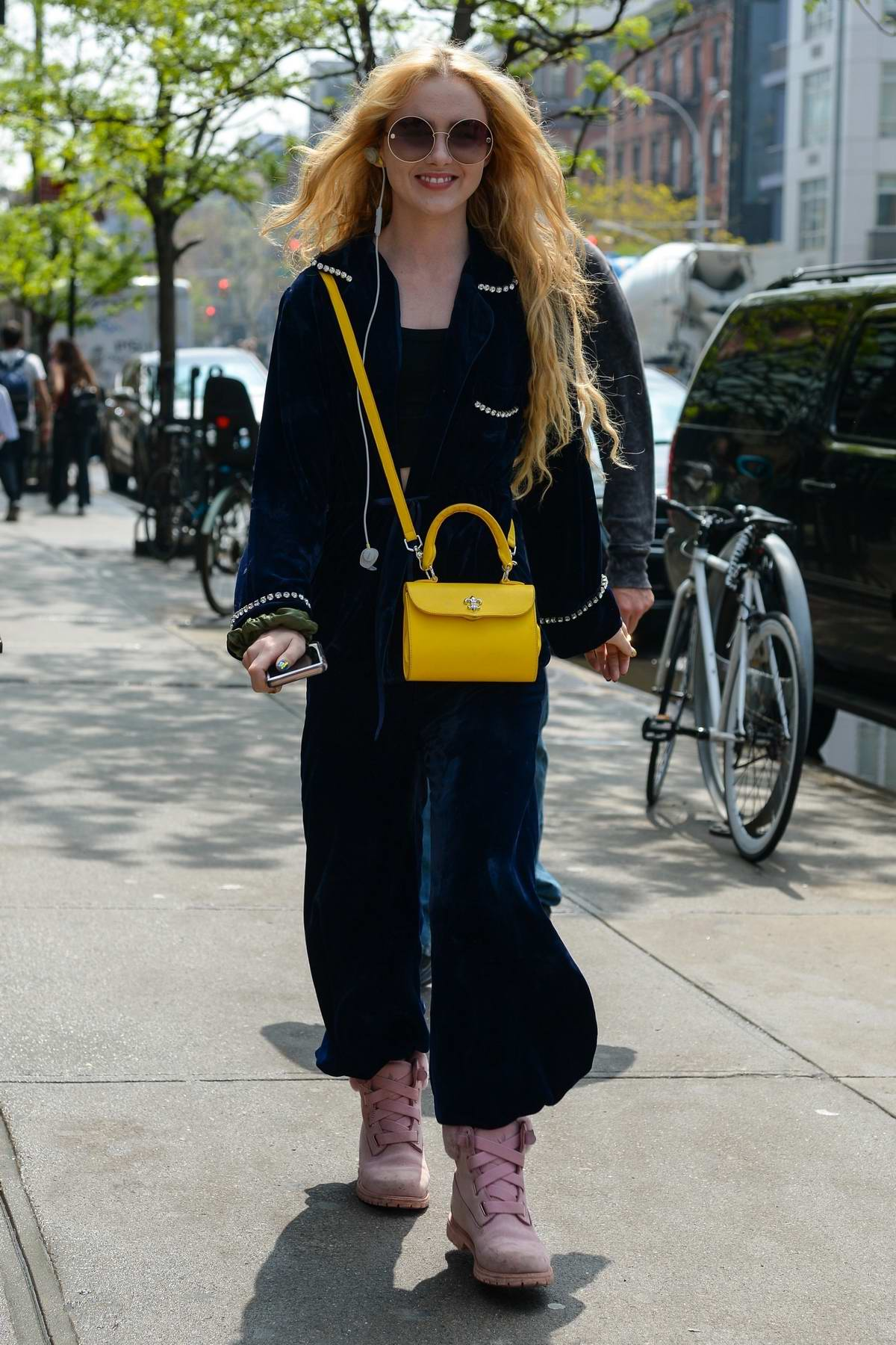 Kathryn Newton smiles for the camera while out in Manhattan, New York City