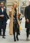 Kathryn Newton waves to the camera while heading to her ride in New York City