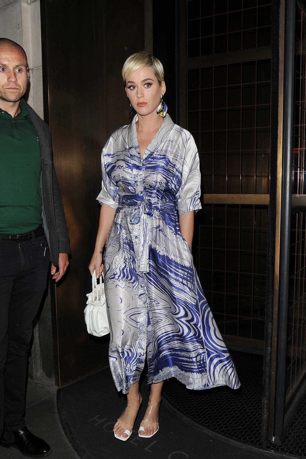 Katy Perry seen leaving her hotel and arriving at Sexy Fish restaurant in London, UK