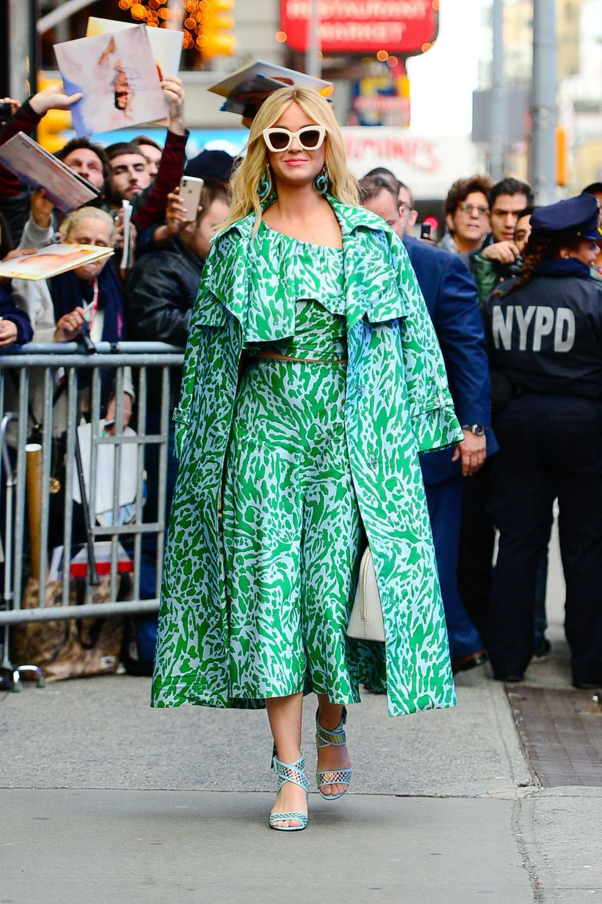 Katy Perry stands out in a green ensemble as she arrives at Good Morning America in New York City