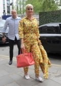 Katy Perry wears a bright yellow floral print jumpsuit as she steps out in London, UK