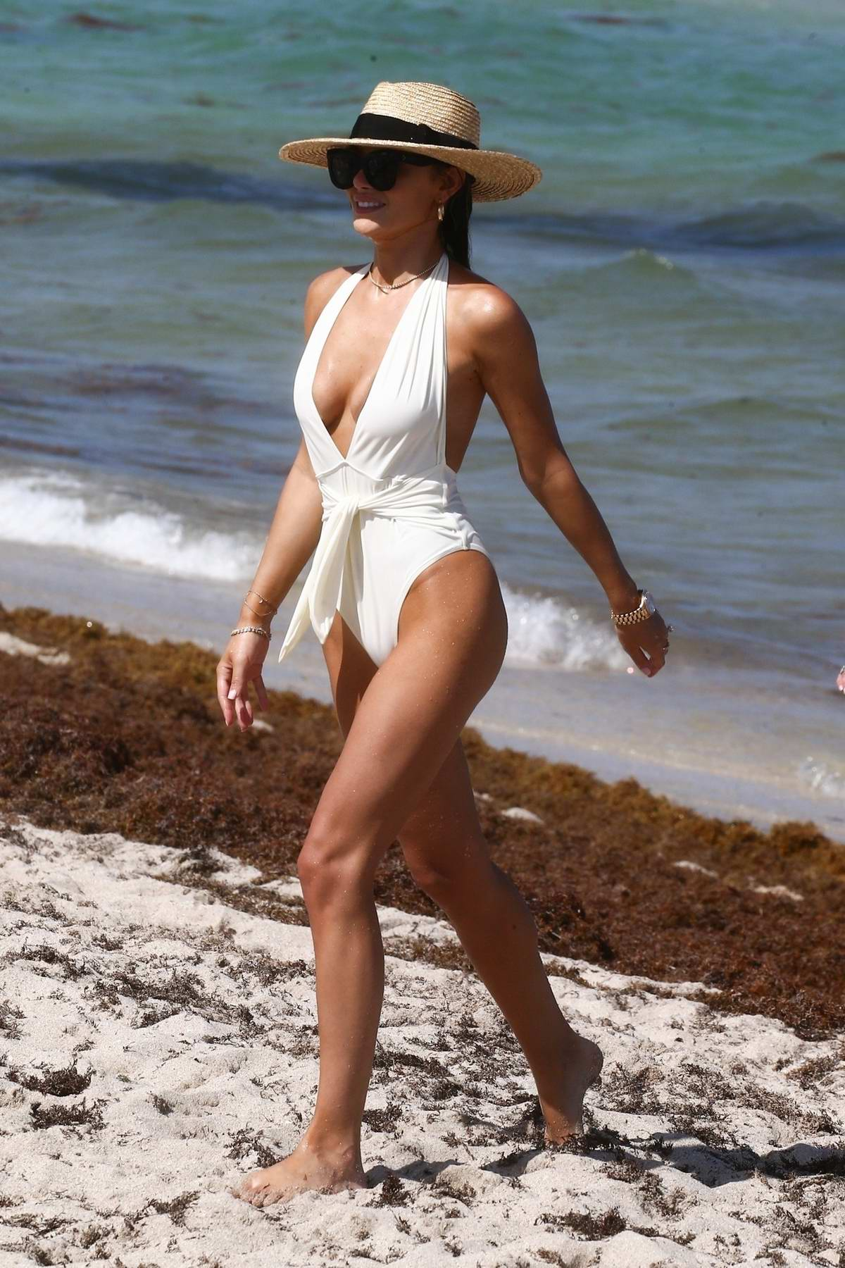 Keleigh Sperry dons a white swimsuit while frolicking with friends for her bachelorette party in Miami, Florida