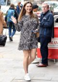 Kelly Brook dons a cute short dress and sneakers as she heads to Global Radio Studios in London, UK