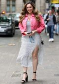 Kelly Brook looks pretty in a cropped pink jacket as she arrives at Global Radio Studios in London, UK
