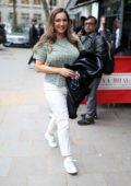 Kelly Brook sports a star print t-shirt and white jeans as she arrives at Global Radio Studios in London, UK